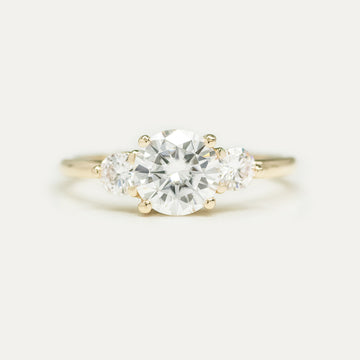 Forever One 7 MM Round Moissanite Three Stone Engagement Ring