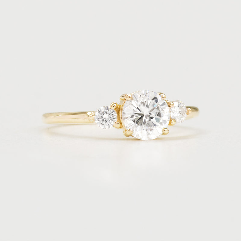 5.50MM Round Moissanite Three Stone Engagement Ring