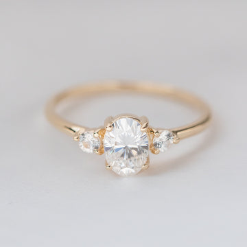 Forever One Oval Moissanite Three Stone Engagement Ring