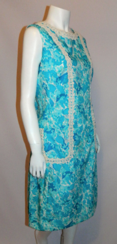 http://retro-trend-vintage.myshopify.com/collections/dresses-suits/products/vintage-lilly-pulitzer-sun-dress-aqua-blue-floral-print-shift-m-l