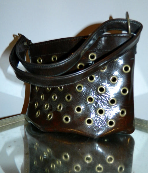 MOD handbag vintage 1960s brown vinyl grommeted purse / brass O rings