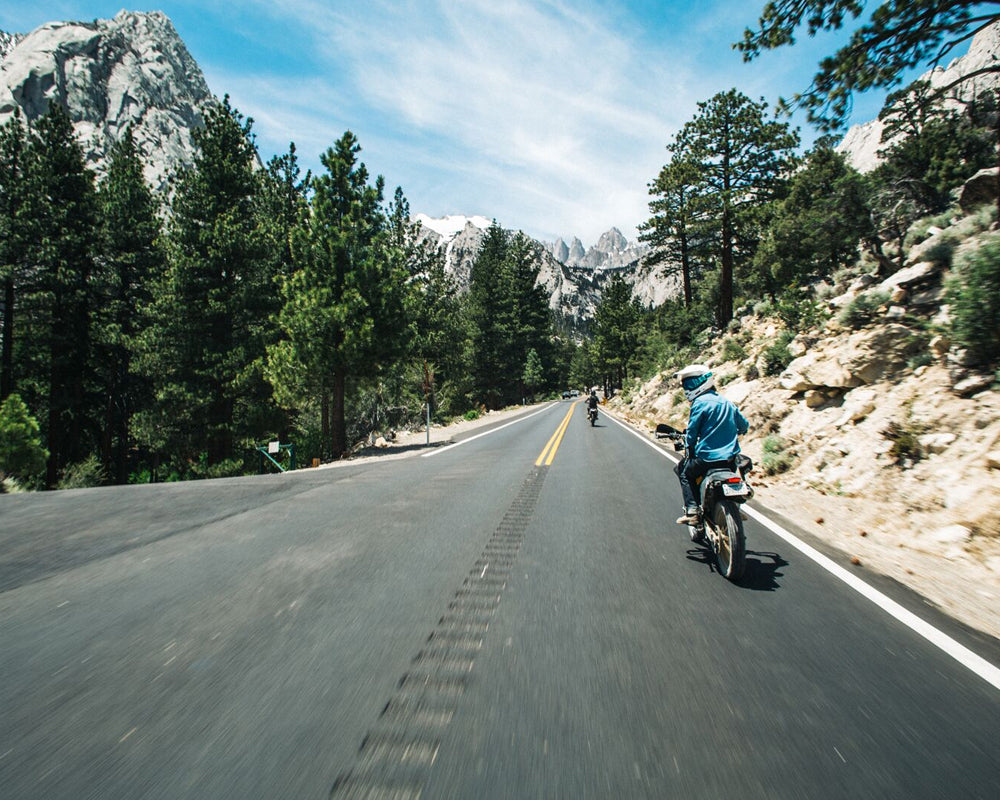 riding dual sport motorcycle through sierras
