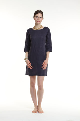 "The Classic Shift Dress is a must-have for every wardrobe.  The most popular of Guru's linen dresses, the Classic Shift features 3/4 length sleeves, a square hem, and an elegant boat-neck design.  Length: 36""  Made out of 100% European Linen.   Available in: White, Black, Navy, Orange and Fuchsia. Machine washable and dryer friendly and Metallic Ivory Herringbone linen, is Dry Clean Only!"
