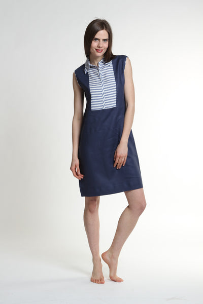 "The Peggy Dress is straight-cut and sleeveless, with cornered collars and striped linen detail.  Length 39""  Made out of 100% European Linen.   Available colors:  solid sand body with sand stripes, solid navy body with navy stripes. Machine washable and dryer friendly."