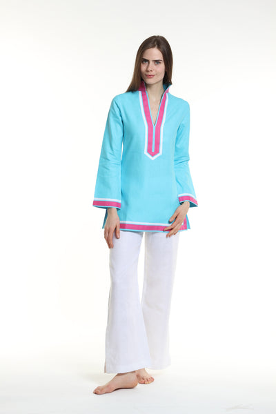 Aqua body, broad trim is fuchsia and thin trim is white.  100% linen, pre shrunk, machine washable and dryer friendly.