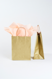 gold paper gift bag with twisted handle