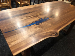 Live edge walnut dining table with sapphire blue epoxy