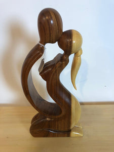 Kissing couple abstract wood sculpture