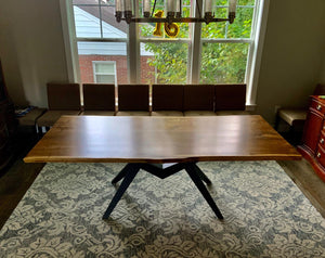 Walnut dining table with mantis base
