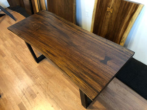 "Live edge acacia wood table 62.5 x 24-26"" in medium brown finish"