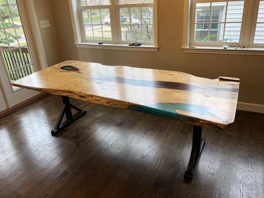 Live edge wood slab table with epoxy