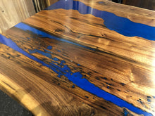 Live edge dining table with epoxy
