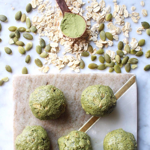 Pumpkin seed matcha balls with pumpkin seeds, matcha powder, and oats. Healthy snack for lunch or a flight.