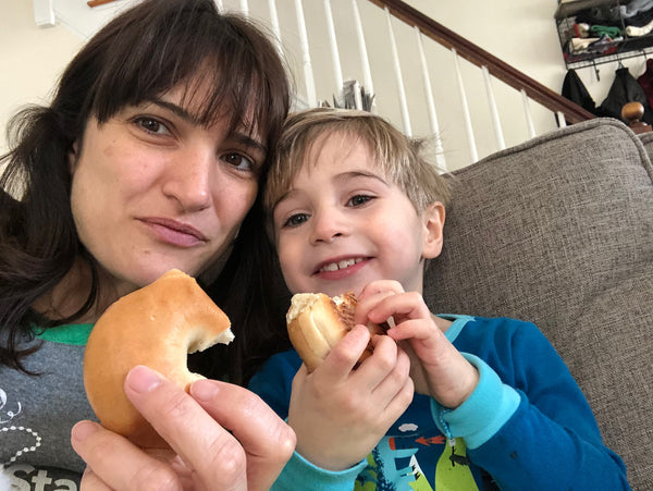 Nicole and Emmett sharing a bagel