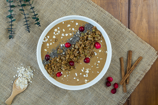 Smoothie bowl topped with granola, fresh cranberries, and chia seeds. Great way to get healthy fats in!