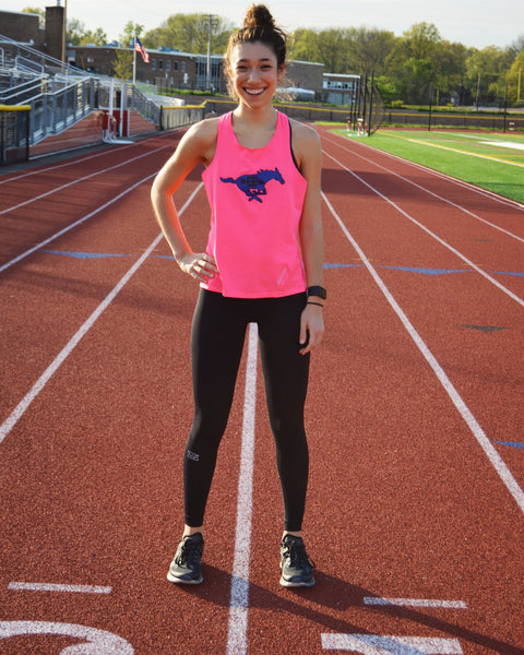 Alyssa Vassallo, semi-professional runner on a track and field.