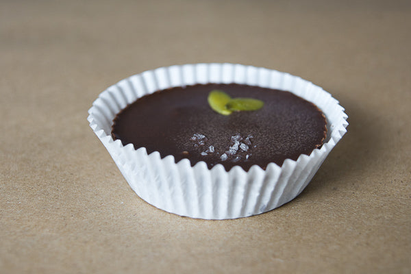 Single pumpkin seed butter chocolate cup with sea salt and pumpkin seeds. Healthy, nut-free option for kids.