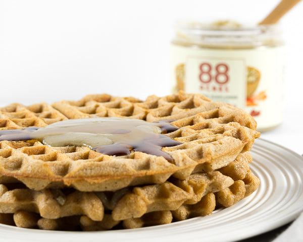 Maple syrup and pumpkin seed butter with waffles. Our newest line of Pumpkin Seed Butter contains no added sugar.