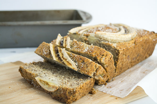 Sliced loaf of fresh banana bread. Grab a slice and take it for the road!