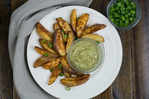 Baked potato wedges with pumpkin seed dip. Great side dish for summer grill recipes.