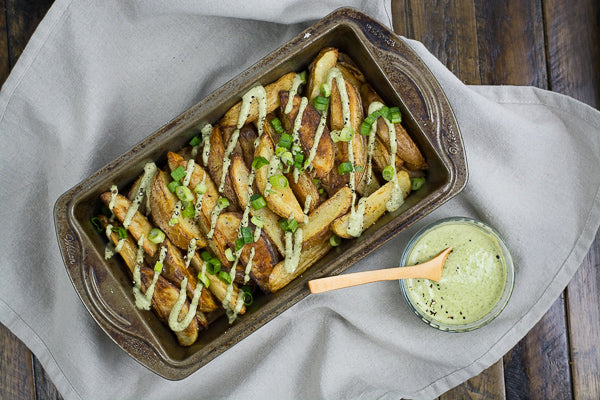 Tray of salt and pepper steak fries, drizzled in pumpkin  seed butter sauce. Perfect for kids and adults.