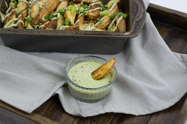 Thick, wedge-cut potato fries dipped in pumpkin seed butter. Healthy fry alternative, great when served as an appetizer.