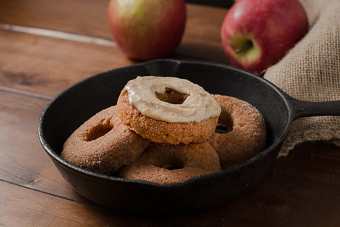 Apple cider donuts topped with maple sunflower seed butter. Kids will love these gluten-free, vegan donuts.