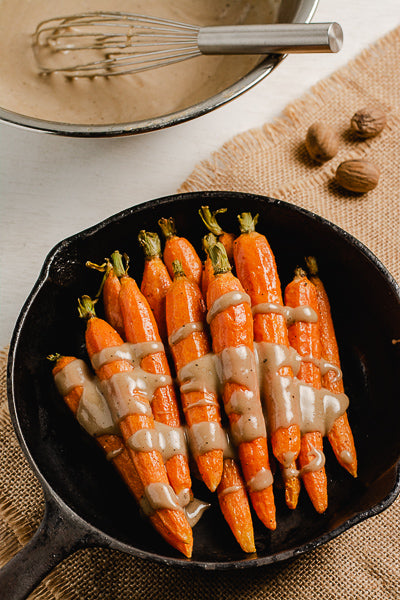 Roasted carrots with maple sunflower seed butter glaze. Makes a great appetizer for dinner or parties.