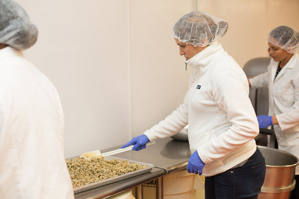 Nicole spreading seed bar mix into bake tray