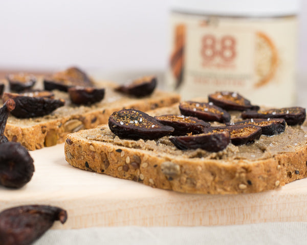 Vanilla spice sunflower seed butter on sprouted grain bread, topped with figs and sea salt. Spice up breakfast, pack for a picnic, or take to the beach!