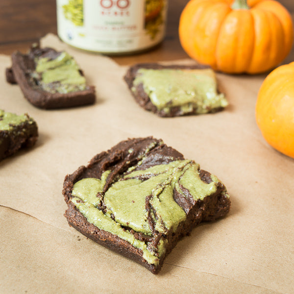 Vegan, flourless black bean brownies with a swirl of pumpkin seed butter. These gluten free brownies are a healthier version of the regular brownie.