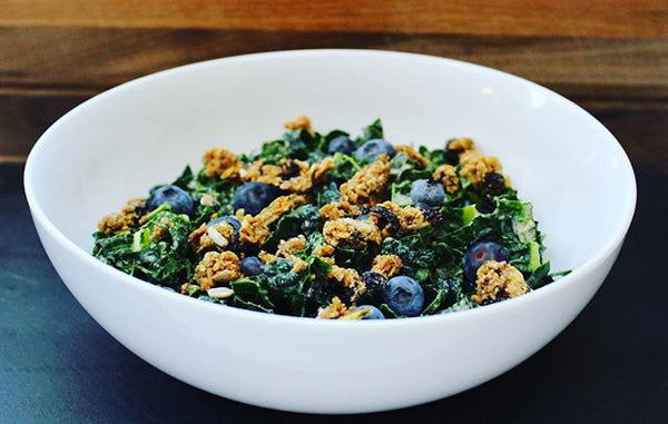 Kale salad with blueberries, seednola, and vanilla spice  sunflower seed butter. Healthy, quick option for lunch.