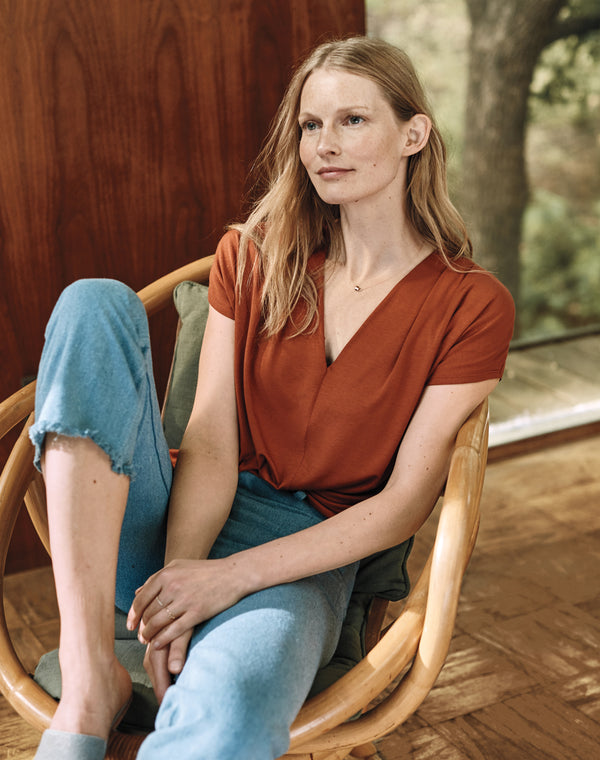 Hartje Andresen model and activist sits in modal drape v-neck tee sustainable fashion