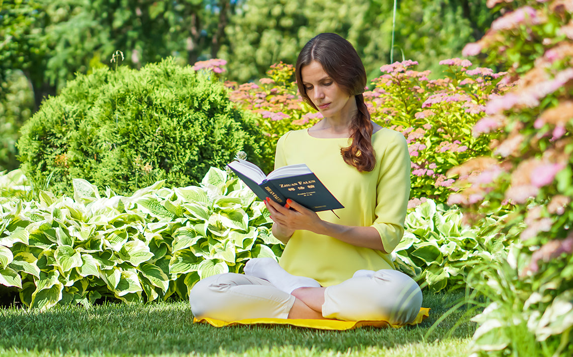 Falun Dafa Practitioner Studying the Book Zhuan Falun