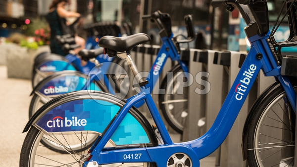 Citi Bikes parked at docking station in Manhattan on sunny summer day