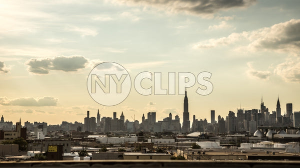 Manhattan skyline silhouette with Empire State Building view from Brooklyn in early evening sunset