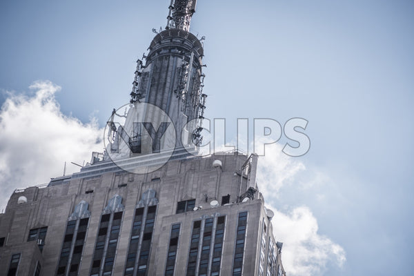 tight close-up shot of top of Empire State Building on grey hazy day