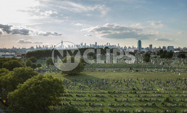 Calvary Cemetery in Queens with Manhattan skyline in background - tombstones in NYC