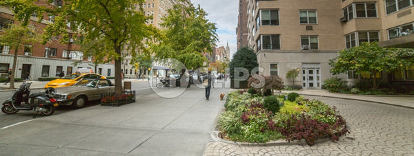 Lower 5th Ave with circular driveway garden in Manhattan NYC