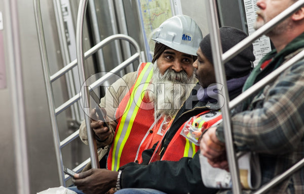 MTA workers on subway - racial and religious harmony on public transportation in NYC