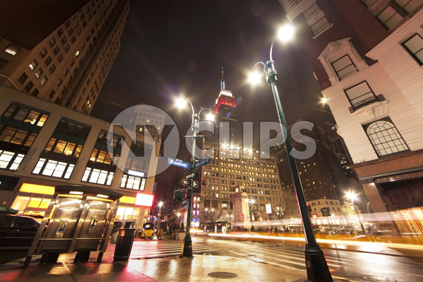 Herald Square with Empire State Building at night in Manhattan New York City NYC