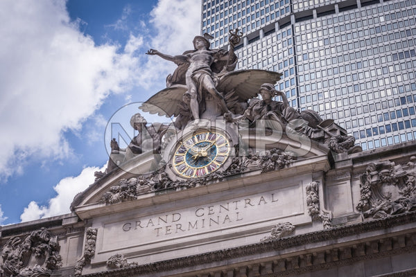 Grand Central Station exterior with clock and statue close up in front of Met-Life Building in Midtown Manhattan