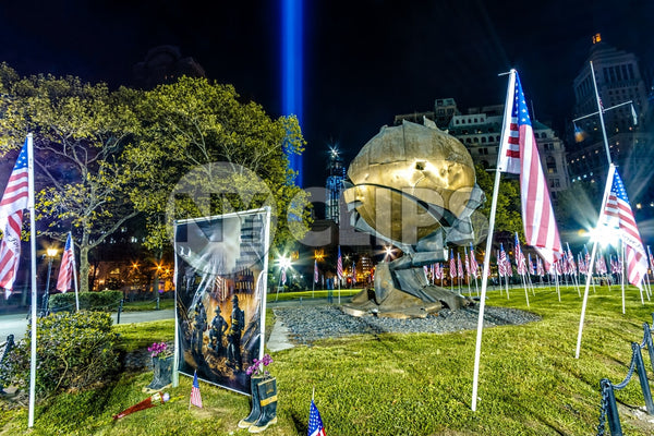 September 11th memorial painting of firefighters - heroes commemorated in Battery Park at night with American flags and 911 beams