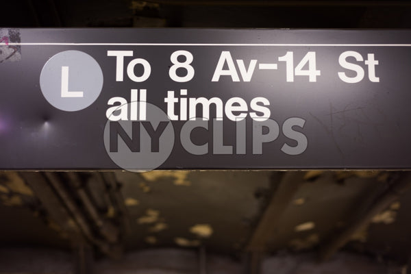 L train all times sign in 8th Ave and 14th st subway station
