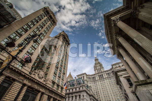 Manhattan Municipal Building in Downtown NYC - civic courthouse with blue sky and clouds on spring day
