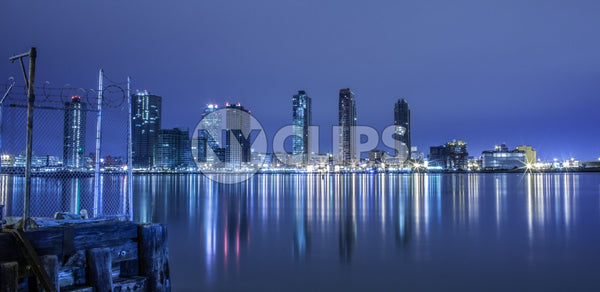 New Jersey skyline view from Westside of Manhattan at night across Hudson River with beautiful reflections in water