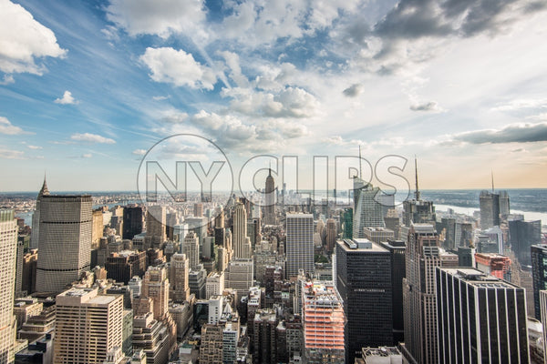 Empire State Building and Manhattan cityscape on bright sunny day with skyscrapers from high view