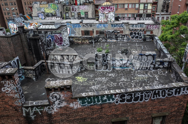 graffiti all over building rooftop - roof with spray paint vandalism art in Brooklyn