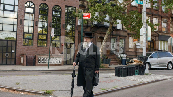 Orthodox Jewish man walking in Williamsburg Brooklyn NYC
