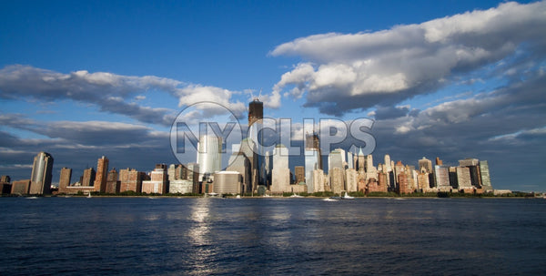 Lower Manhattan skyline with Freedom Tower and skyscrapers on summer day with blue sky